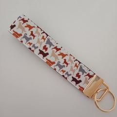 Brown and grey dog print key fob wristlet