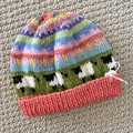 Coral sheep Beanie - to fit approx size 6-12 months -hand knitted