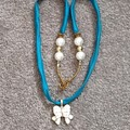 Turquoise Silk with a Bow