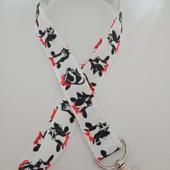 Black and white cow with red bow lanyard / ID holder / badge holder