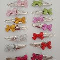 Glitter bow silver snap hair clips