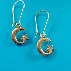 Gold moon and star earrings