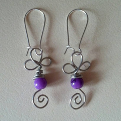 Handcrafted wire earrings with purple beads
