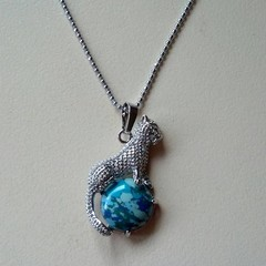 Silver leopard charm necklace with imitation turquoise stone