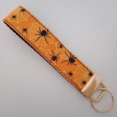 Orange and black spider / cobweb print key fob wristlet
