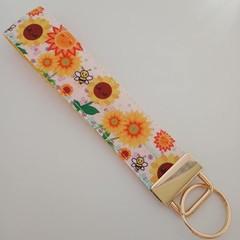 Orange and yellow sunflower key fob wristlet