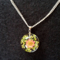 Pink resin flower charm silver necklace