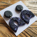 Black and purple clay dangle earrings with hypoallergenic studs.