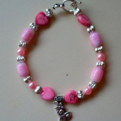 Pink and silver beaded bracelet with dog charm