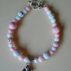 Pink and white beaded bracelet with fantasy / fairy tale coach charm