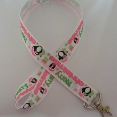 Pink and green penguin print Christmas lanyard / ID holder / badge holder