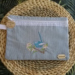 Embroidered zippered Pouch.