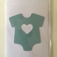 New baby card - blue jumpsuit heart cut out.