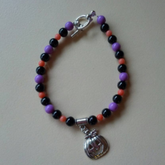 Purple black and orange Halloween pumpkin beaded bracelet