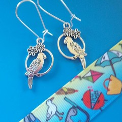 Silver parrot / tropical flower earrings