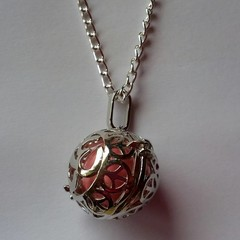 Silver pink harmony ball with peace filigree detail necklace