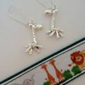 Silver giraffe charm earrings