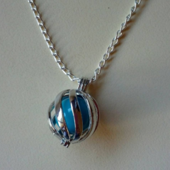 Silver and blue harmony ball with twist pattern necklace