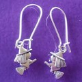 Silver witch on broom Halloween earrings