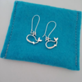Silver whale cut out charm earrings