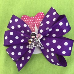 Large purple and white spotted pinwheel bow - with embellishment.
