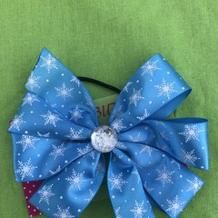 Large blue and white snowflake pinwheel bow - with embellishment.