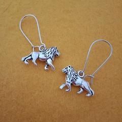 Silver lion charm earrings
