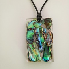 Paua shell set in resin with adjustable leather cord