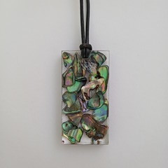 Paua Shells set in Resin with adjustable Leather Cord.