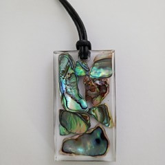 Paua Shells set in Resin with adjustable sliding cord.