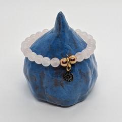 Rose quartz gemstone bracelet with mandala charm