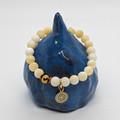 Yellow calcite gemstone bracelet with mandala charm