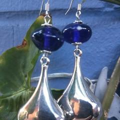Voluptuous metal teardrop earrings with unusual vintage eliptoid blue beads.