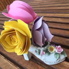 Small handcrafted paper flowers in a repurposed ornament