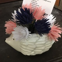 Small handcrafted paper flowers in a repurposed plant pot