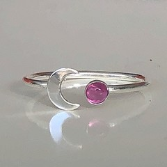 Silver moon with garnet ring