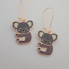 Gold enamel koala earrings