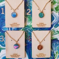Delicate and pretty pendant on gold chain
