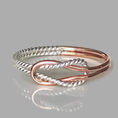 Rose gold and silver knot ring
