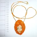Glass and polymer clay face pendant