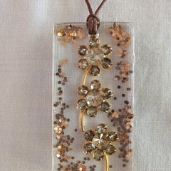 Upcycled jewellery encased in Resin Pendant with adjustable waxed cotton cord