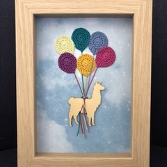 Llama with crocheted balloons frame