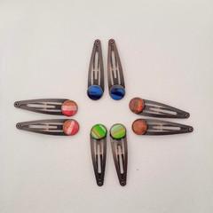 A pair of pretty bronze hair clips
