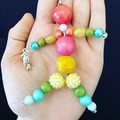 Tropical beaded person keyring with parrot charm