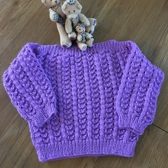 Hand knitted lacy jumper for that special girl