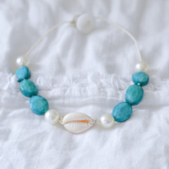 Cowrie shell With Blue faceted Glass Beads