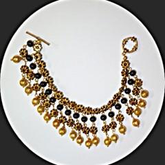 Glass, acrylic and gold metal dangle bracelet