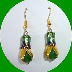 Emerald, gold and enamel earrings.