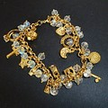 Knock out gold and crystal charm bracelet