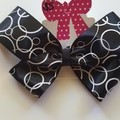 Black with white circle pattern bow.